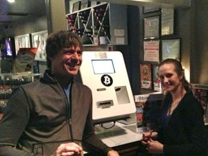 February 10, 2014: enchanted bitcoins' Bitcoin kiosk, permanently installed and available to the public daily. Left: Eric Stromberg, founder of enchanted bitcoins. Right: Cathy Chenevey, bar manager at Imbibe.
